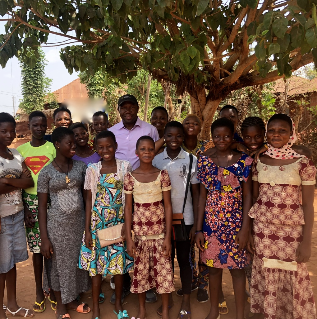 Peter with some of the girls he supports in Benin Republic